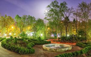 Картинки Россия Парки Весна Фонтаны Вечер Деревья Кусты Уличные фонари Sakhalin Природа