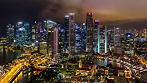 Фотография Сингапур Здания Небоскребы Мост Мегаполиса Ночь Города