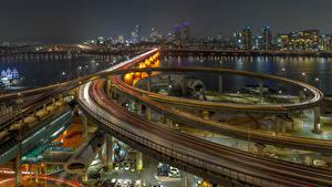 Картинка Южная Корея Здания Река Мост Дороги Ночью Город Города