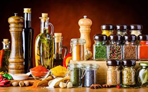 Фото Приправы Бадьян звезда аниса Чеснок Перец чёрный Банки Бутылки Масло Пища