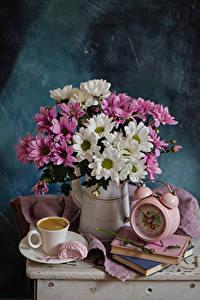 Фотографии Натюрморт Букет Хризантемы Часы Кофе Кувшины Книга Чашка Цветы