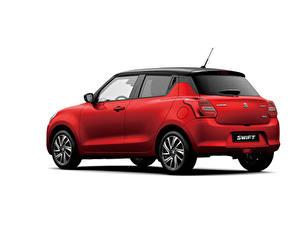 Фотографии Suzuki - Автомобили Красные Металлик Белый фон Swift Hybrid, 2020 Автомобили