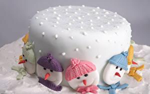 Фотографии Сладости Торты Рождество Сахарная глазурь Снеговик Шапка