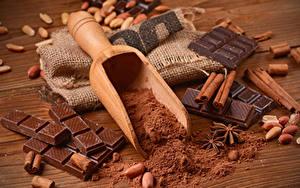 Фото Сладкая еда Шоколад Корица Орехи Какао порошок