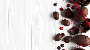 Фотографии Сладости Пасха Шоколад Доски Яиц Бант