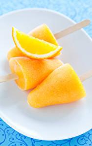 Фотография Сладости Мороженое Апельсин Желтый Еда
