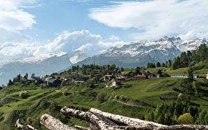 Фото Швейцария Здания Горы Альп Облака Veulden Города