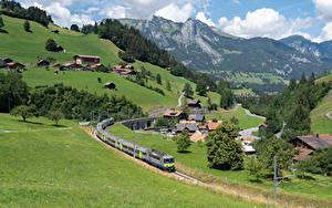 Фото Швейцария Дома Железные дороги Гора Альпы Село Zweisimmen Города