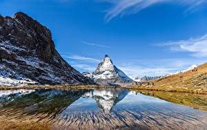 Обои Швейцария Гора Озеро Небо Утес Природа