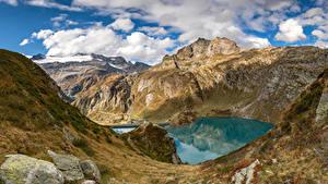 Картинки Швейцария Гора Озеро Камень Альпы Облачно Скала Ticino, Lago di Robièi Природа