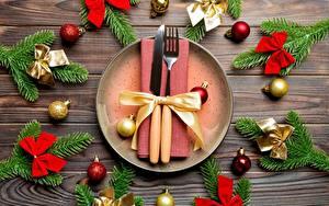 Фото Накрытия стола Рождество Ножик Ветвь Шар Бантики Вилки Тарелке