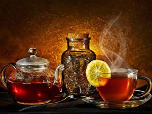 Фото Чай Чайник Лимоны Чашке Банке Паром Пища
