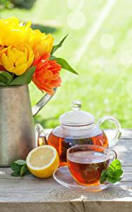 Фотографии Чай Чайник Лимоны Тюльпаны Чашка Еда