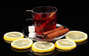 Фото Чай Лимоны Корица Черный фон Чашка Сахар Продукты питания