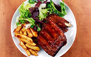 Картинки Вторые блюда Мясные продукты Картофель фри Овощи Тарелке