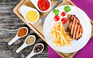 Фотографии Вторые блюда Мясные продукты Картофель фри Помидоры Специи Доски Тарелка Кетчупом Продукты питания