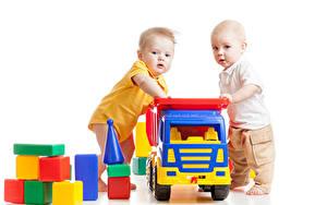 Фотографии Игрушки Белый фон Двое Мальчик Грудной ребёнок