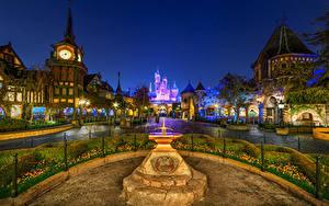 Фотография Штаты Диснейленд Парки Здания Памятники Часы Замок Калифорния Ночью Уличные фонари Кустов город