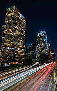 Фотография США Здания Небоскребы Дороги Лос-Анджелес Ночь Скорость город