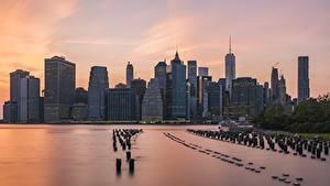 Картинка США Небоскребы Рассветы и закаты Нью-Йорк Манхэттен Мегаполис город