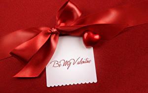 Фотографии День всех влюблённых Красный фон Ленточка Бантик Лист бумаги Английский