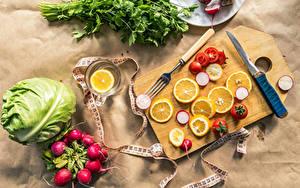 Фотографии Овощи Лимоны Редис Капуста Томаты Ножик Разделочная доска Чашке Вилка столовая Пища