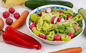 Фотография Овощи Редис Перец овощной Морковь Огурцы Тарелка Продукты питания