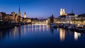 Картинки Цюрих Швейцария Здания Речка Мост Вечер Пирсы Речные суда город