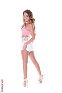 Фотография iStripper Alexis Adams Белым фоном Поза Смотрит Рука Юбке Ноги Туфлях молодая женщина