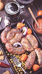 Фотография Мясные продукты Пиво Кружка Вилка столовая Пища