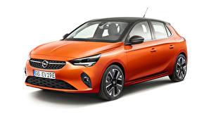 Фото Opel Белым фоном Оранжевый 2019-20 Corsa-e Автомобили