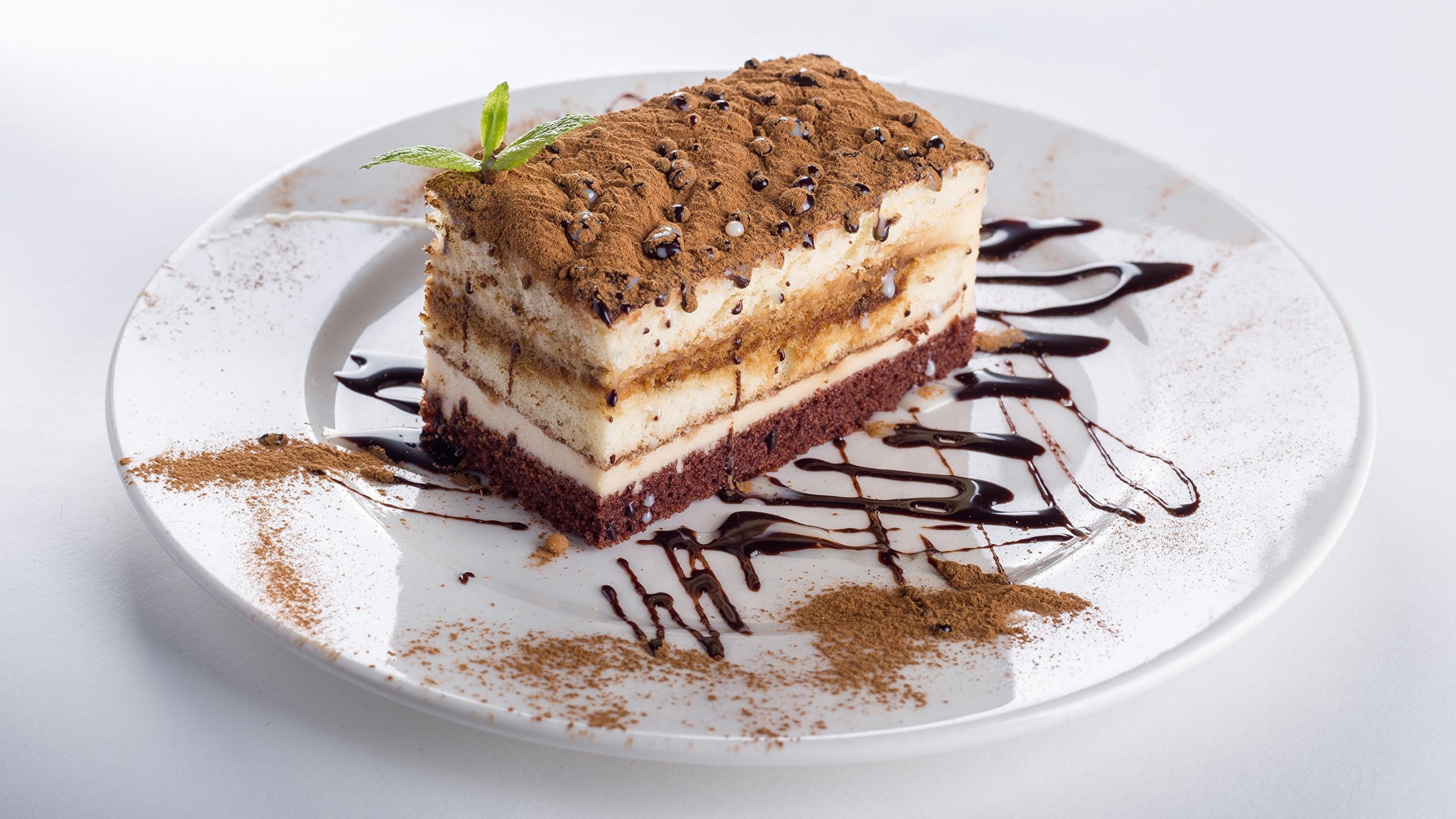 Фотографии Торты Какао порошок кусочек Еда Тарелка 2560x1440 часть Кусок кусочки Пища тарелке Продукты питания