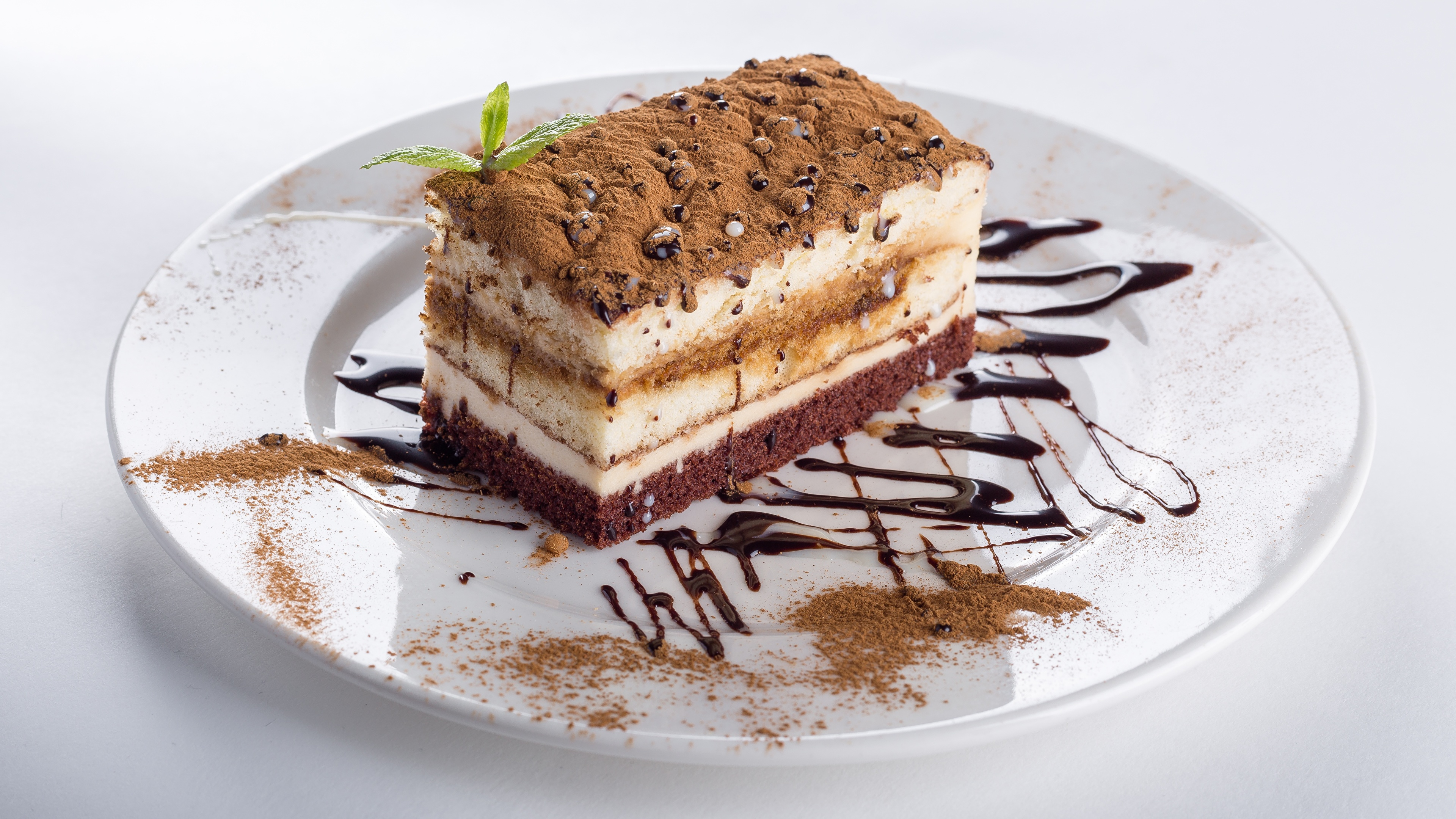 Фотографии Торты Какао порошок часть Еда Тарелка 3840x2160 Кусок Пища тарелке Продукты питания