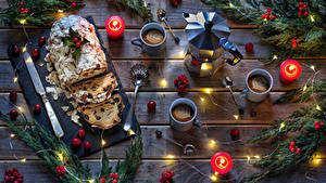 Картинка Рождество Выпечка Кекс Свечи Кофе Чайник Ягоды Изюм Доски Ветвь Чашке Ложки Пища