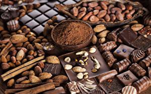 Фотография Сладости Шоколад Орехи Конфеты Корица Какао порошок