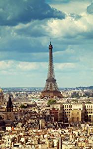 Фотографии Франция Здания Небо Париж Мегаполиса Эйфелева башня Облака Города