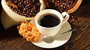 Фотография Кофе Печенье Зерна Чашка Ложка Еда