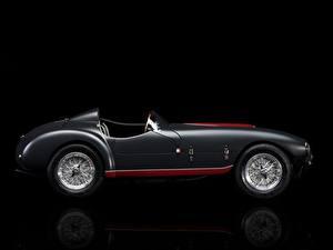 Фото Феррари Ретро Черный фон Сбоку 1953 Classic 166 MM/53 Spyder авто