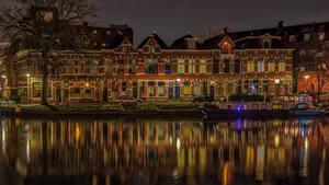 Фотографии Нидерланды Здания Реки Причалы Ночь Уличные фонари Groningen Города