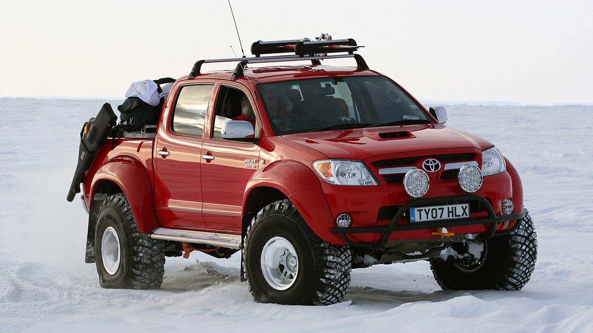 Фотографии Тойота 2007 Arctic Trucks Hilux Invincible AT38 Пикап кузов красная Металлик Автомобили 1920x1080 Toyota красных красные Красный авто машина машины автомобиль