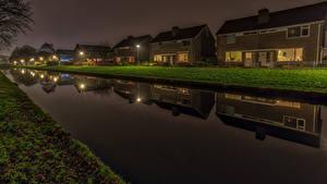 Обои Нидерланды Здания Вечер Водный канал Улица Уличные фонари Groningen город