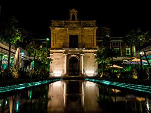 Фотография Испания Здания Пруд Ночные Capilla de la Virgen del Puerto Malaga Города