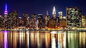 Картинки США Дома Небоскребы Река Нью-Йорк Ночь Города
