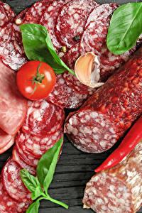 Фотографии Мясные продукты Колбаса Помидоры Перец Нарезанные продукты Пища