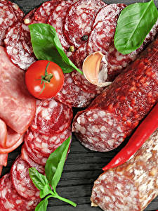 Фотографии Мясные продукты Колбаса Томаты Перец Нарезка Пища