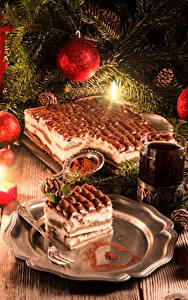 Фотографии Рождество Праздники Торты Свечи Чай Доски Ветки Шарики Шишки Стакана Пища