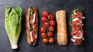Картинка Быстрое питание Сэндвич Булочки Ветчина Томаты Капуста Серый фон Пища