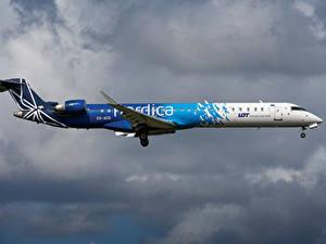 Фото Самолеты Пассажирские Самолеты Сбоку Nordica, Bombardier, CRJ-900