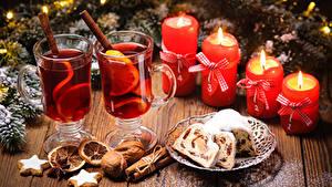 Фото Новый год Кекс Орехи Корица Свечи Напитки Печенье Доски Стакан Пища