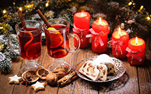 Фото Рождество Кекс Орехи Корица Свечи Напитки Печенье Доски Стакан Пища